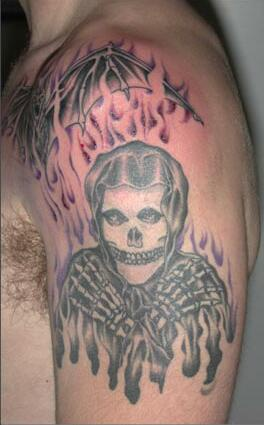 Misfits skeleton in flame tattoo