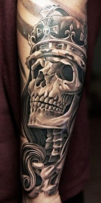 Amazing skull in a crown tattoo