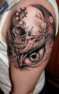 Clock with skull and eye tattoo on shoulder