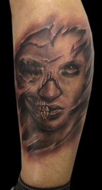 Skull face lady tattoo