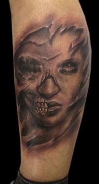Skull face lady tattoo
