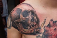 Skull tattoo by graynd on the shoulder
