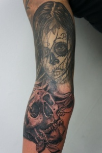 Skull tattoo on arm by graynd