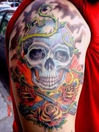 Skull tattoo on arm by mojoncio