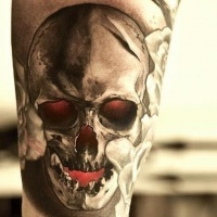 Skull tattoo with red eyes