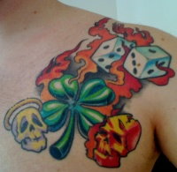 Angel and devil skull with dice and clover tattoo