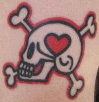 Skull with heart and crossbones tattoo